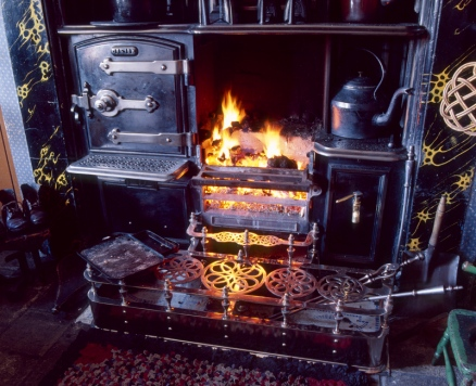 """A roaring fire in one of the """"pit village"""" houses at Beamish Museum ; some yummy scones had just come out of the oven on the left of the fire"""